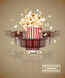 Jumping popcorn and movie film tape Stock Image