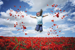 Jumping in poppies field Stock Image