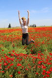 Jumping in poppies Royalty Free Stock Image