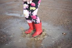 Jumping in puddles royalty free stock photography