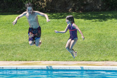 Jumping in pump. Children jumping in pump together in an outdoor pool Stock Images