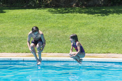 Jumping in pump. Children jumping in pump together in an outdoor pool Stock Photography