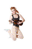 Jumping punk girl with fiddle. Royalty Free Stock Photography