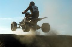 Jumping with a quad. During a race Stock Images