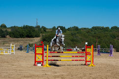 Jumping qualifier. Horse racing. Stock Photo