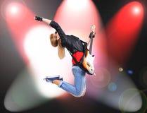 Jumping rocker girl Royalty Free Stock Photo