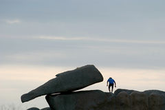 Jumping from the rocks of the Pink Granite Coast in Bretagne Stock Photo