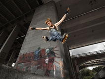 Jumping rollerskater Stock Photos