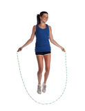 Jumping rope. Teen jumping rope on white background Royalty Free Stock Images