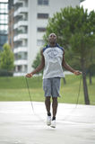 Jumping Rope. Young man jumping rope outdoors Stock Photography