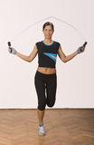 Jumping rope. Young woman doing exercises with a jumping rope Stock Image