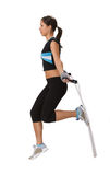 Jumping rope. Young woman doing exercises with a jumping rope Royalty Free Stock Images