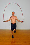 Jumping rope for cardiovascular exercise Stock Photos