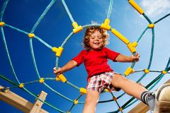 Jumping from ropes on playground Royalty Free Stock Image