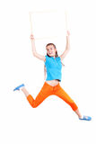 Jumping or running teenage girl with empty board Stock Image
