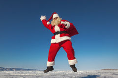 Jumping Santa Claus  outdoors Royalty Free Stock Images