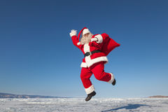 Jumping Santa Claus  outdoors Royalty Free Stock Photography