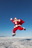 Jumping Santa Claus  outdoors Royalty Free Stock Image
