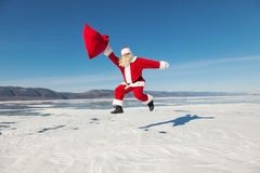 Jumping Santa Claus  outdoors Royalty Free Stock Photo