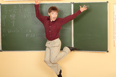 Jumping schoolboy Royalty Free Stock Image