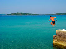 Jumping into the sea. royalty free stock images