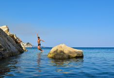 Jump into the sea. Jumping into the sea. Funny beach entertainment on a beautiful beach royalty free stock photos