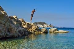 Jump into the sea. royalty free stock photo