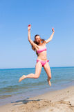Jumping at Seaside Royalty Free Stock Images
