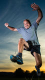 Jumping senior Stock Photography