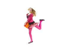 Jumping shopper. Jumping teenager girl isolated over white with clipping path Royalty Free Stock Photography