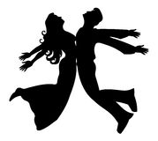 Jumping silhouette. Of boy and girl Stock Photography