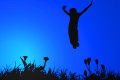 Jumping silhouette. Silhouette of a girl jumping over grass silhouette with blue background Stock Photo