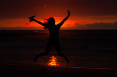 Jumping silhouette. Jumping in front of the sunset Stock Image
