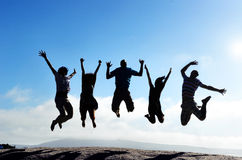 Jumping silhouettes Royalty Free Stock Image