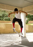 Jumping on a skateboard Stock Photos