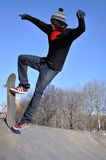 Jumping skater. This picture represents a skater jumping on a ramp at Astoria Park, New York City. It could be used to illustrate radical sports. The picture was Stock Photography