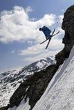 Jumping skier Stock Image