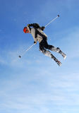 Jumping skier. Young freestyle male skier jumping and rotating in stunt high in the air Stock Images