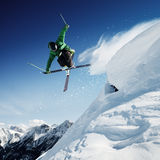 Jumping skier in high mountains on the ski Stock Photo