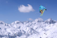 Jumping skier. At jump inhigh mountains at sunny day Stock Photography