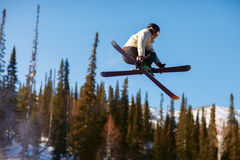 Jumping skier Stock Photo