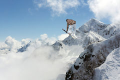 Jumping skier in mountains. Extreme sport, freeride. Royalty Free Stock Photography
