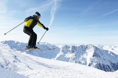 Jumping skier at mountains Royalty Free Stock Photo