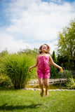Jumping with skipping rope Stock Images