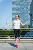 Jumping with skipping rope Stock Photo
