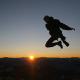 Jumping in the sky. During sunset Stock Photos