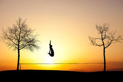 Jumping on slackline Royalty Free Stock Image