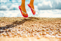 Jumping in slippers on the beach Stock Image