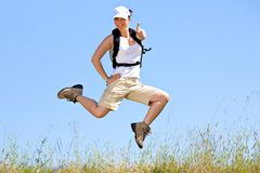 Jumping and smiling Royalty Free Stock Images