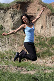 Jumping smiling girl. Jumping smiling brunnet girl on the nature Royalty Free Stock Image